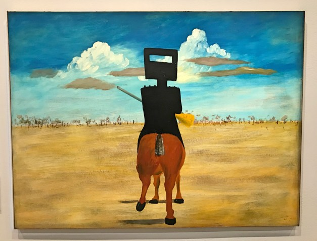 """One room was entirely dedicated to 27 pieces Sidney Nolan painted in the mid-20th century about Ned Kelly. Who is Ned Kelly you ask? Well then, you're obviously not Australian. He was, I learned, Australia's most famous """"bushranger"""", a legendary symbol of Australia's lawless frontier. Sort of Jesse James, I guess. Amazing what you can learn from going to an art museum."""
