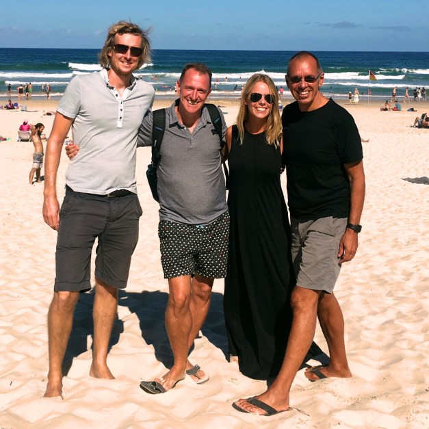 Piers, Mark, Charlotte, and Jim on the beach that puts the paradise into Surfers Paradise
