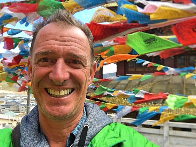 Mark enjoying Shangri-La's temple and prayer flags before his little accident