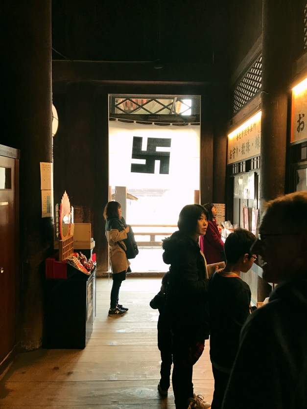 These reverse swastikas were Buddhist images for centuries before the Nazis adopted them. Still, it's always a little jarring seeing them around....