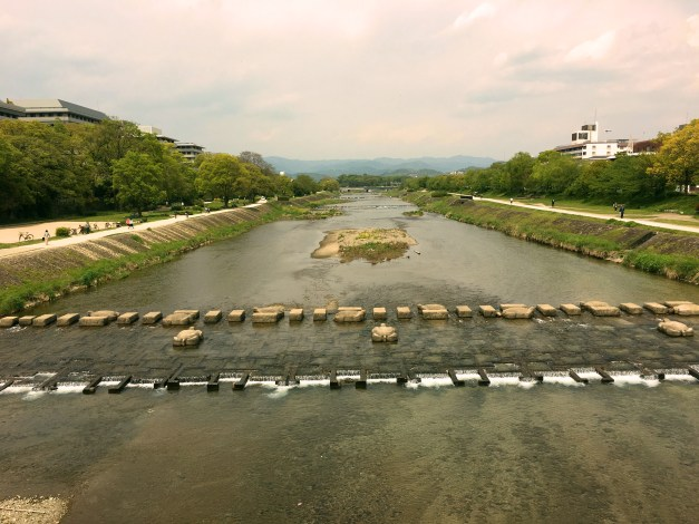 The Kamo River, running right through the heart of Kyoto. The water was clean and shallow and periodically you'd see kids playing in it. And while there were big modern bridges across the river for traffic at several places there were also these large boulders (some in the shape of turtles) that allowed people to walk/jump from one side to the other without having to go up onto a bridge.