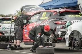 Working on a Clio Cup Car in the Paddock Thruxton