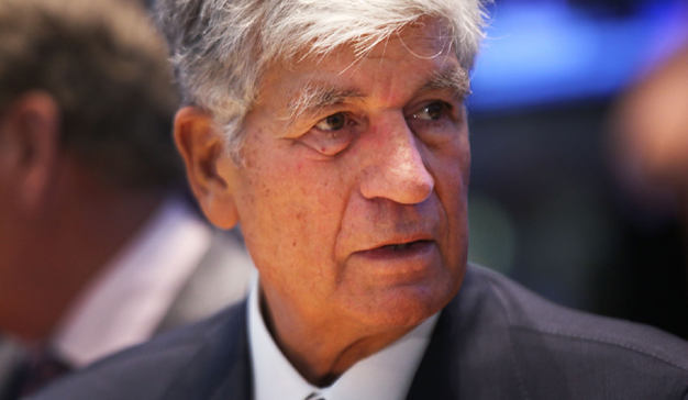 NEW YORK, NY - JULY 29: Publicis CEO Maurice Levy stands on the the floor of the New York Stock Exchange a day after announcing that Omnicom Group and Publicis Groupe will merge to form the world's largest advertising holding company on July 29, 2013 in New York City. Assuming the deal is apporved, the company will be called Publicis Omnicom Group and be led by Omnicom CEO John Wren and Levy. Spencer Platt/Getty Images/AFP