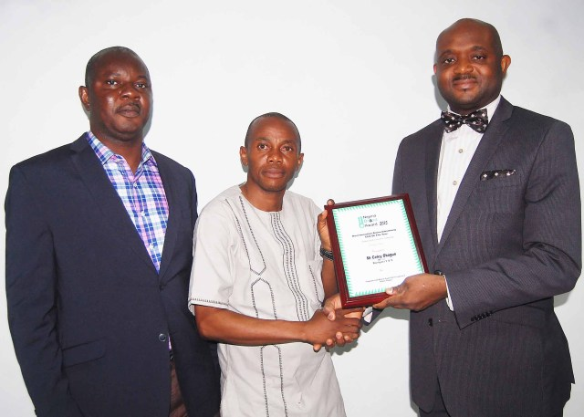 MD, Novelpotta receives award from Abidemi Adesanya, project director, Nigeria Brand Awards