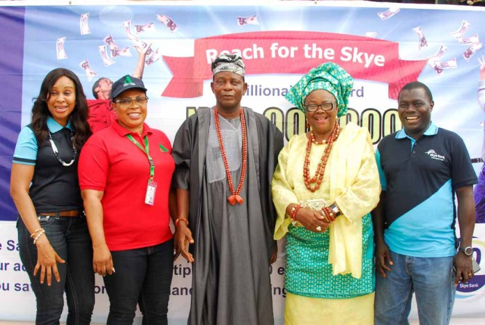 "L-R: Group Head, Retail Banking, Skye Bank, Nkolika Okoli, Acting Zonal Coordinator, National Lottery Regulatory Commission, Akure Zone, Mrs. Seyi Audu, Babaloja of Akure Kingdom, Chief Olowu Ige, Iyaloja of Akure Kingdom, Erelu Chief (Mrs.) M. Adekanye and Regional Manager , Ondo/Ekiti Region , Skye Bank Plc. Rasheed Yusuf at the Bank's 11th ""Reach For The Skye Millionaire"" reward Scheme held in Oba Market, Akure , Ondo State recently."