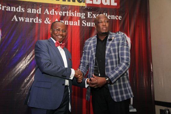 L-R: Seni Adetu, Former Managing Director, of Guinness Nigeria Plc presenting the Marketing Personality of the Year Award (2016) to Martin Mabutho, General Manager, Marketing, MultiChoice Nigeria during the Marketing Edge, Brands and Advertising Excellence Awards and Annual Summit 2016 held at Civic Center, Victoria Island, Lagos on Friday 17th of June, 2016.
