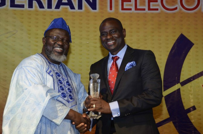 R-L: MD/CEO, Airtel Nigeria, Segun Ogunsanya while receiving the award for the Telecoms CEO of the Year from the Honourable Minister of Communications, Barrister Adebayo Shittu at the 2016 Nigeria Telecom Award held on Saturday in Lagos.