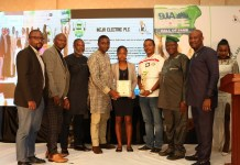 Third from left, Mr Steve Doriigi, Operation Manager, Ikeja City Mall and third from right, Hon. Kehinde Bamigbetan, Commissioner for Information and Strategy, Lagos State and Ikeja Electric Safety Officers displaying their awards during 2018 Nigeria Safety Award for Excellence (9jaSAFE Award) in Lagos-marketingspace.com.ng