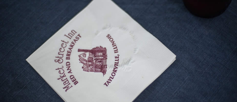 Napking with Market Street Inn Bed and Breakfast stamped on it with a pic of the house and address