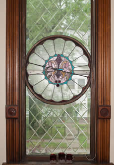 Window with a stain glass window in Pick and Toulouse , wood trim