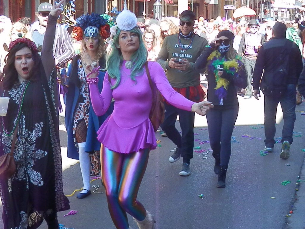 (A woman struts at a New Orleans parade on February 9, Mardi Gras Day / Scott Beyer)
