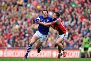 Kerry footballer, left, runs past Mayo opponent. Irish Independent photo.