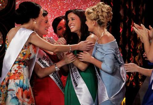 Winner Haley O Sullivan from Texas is congratulated by fellow contestants at last year's Rose of Tralee event. Image from Irish Independent.