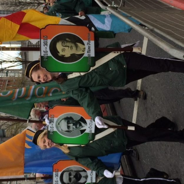 Parading in Dublin with images of Easter Rising patriots. Photo courtesy of Sr. Cathy Cahill.