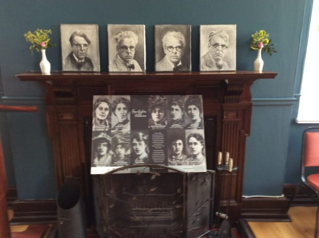 Four charcoal renderings of Yeats. Photos of women below him are the wives of leaders executed after the 1916 Rising.