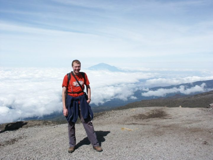 Me at the top of the Barranco Wall, during my first ascent of Kilimanjaro in 2012. Back in those days I used to wear beer tee-shirts (and I had some hair).