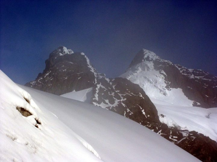 Alexandra and Margherita, the two main summits of Mount Stanley, glimpsed through a fine mist on the Stanley Plateau