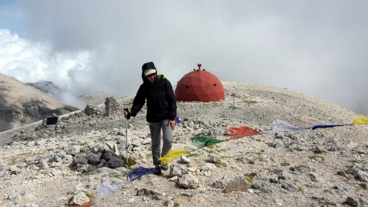 Edita arrives on the summit of Monte Amaro among golf ball shaped huts and Buddhist prayer flags
