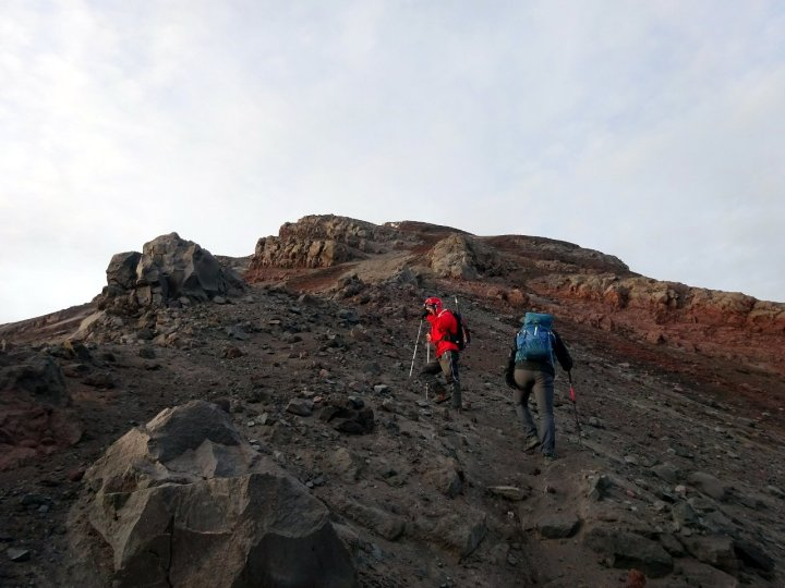 Approaching the crater rim on slopes loaded with loose rock
