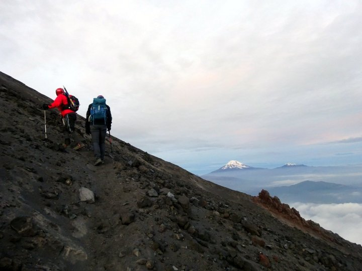 Gonzalo and Edita plod slowly up Tungurahua with Chimborazo and Carihuairazo on the horizon