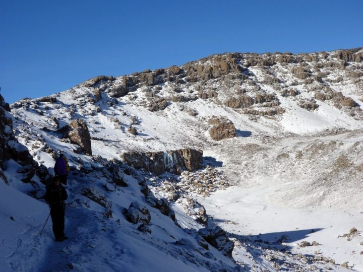 On the crater rim between Gillman's Point and Stella Point, with Uhuru Peak up ahead and the outer crater down below