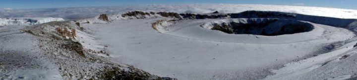 Kilimanjaro's spectacular inner crater and ash pit, with the Northern Icefield to the right, on the perimeter of the outer crater