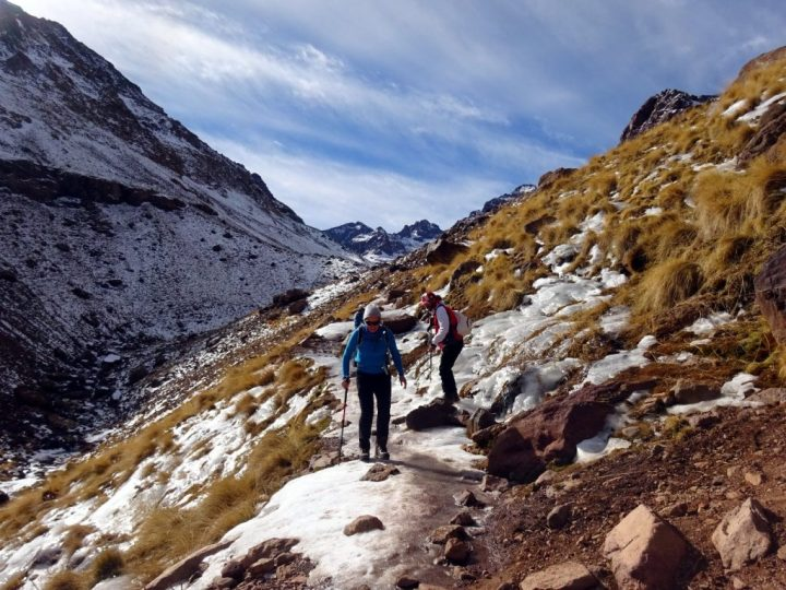 Descending an icy trail from Toubkal Refuge, with Ras n-Ouanoukrim and Akioud behind