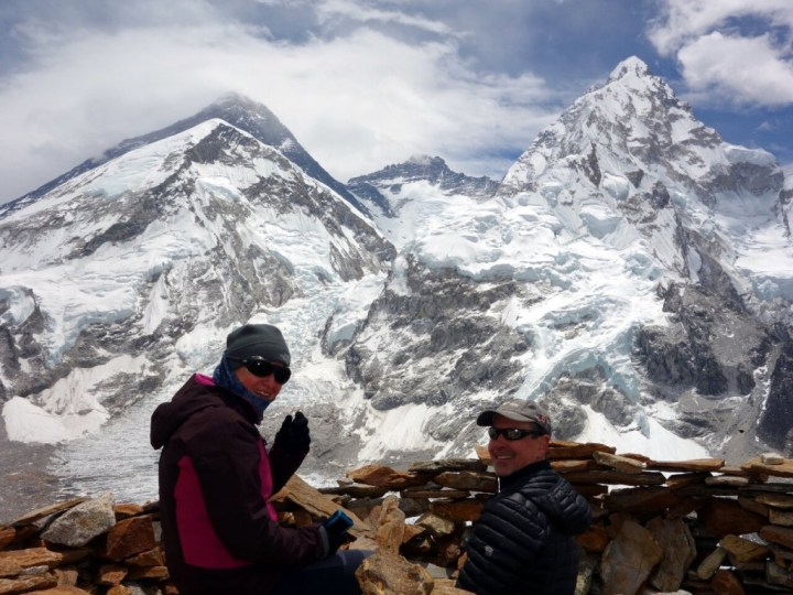 Edita and Kevin enjoy the view of Everest and Lhotse from Pumori Camp 1