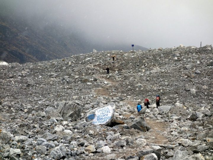 The wasteland of old Langtang is now being used to advertise accommodation in the new village