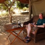 Scribbling down my diary at a safari camp in Zambia