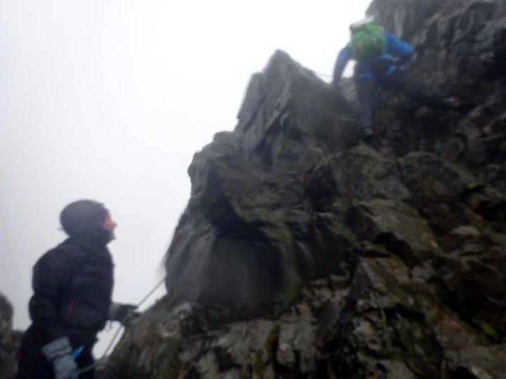 A short rock climb on an increasingly rain-lashed Sgurr a' Ghreadaidh