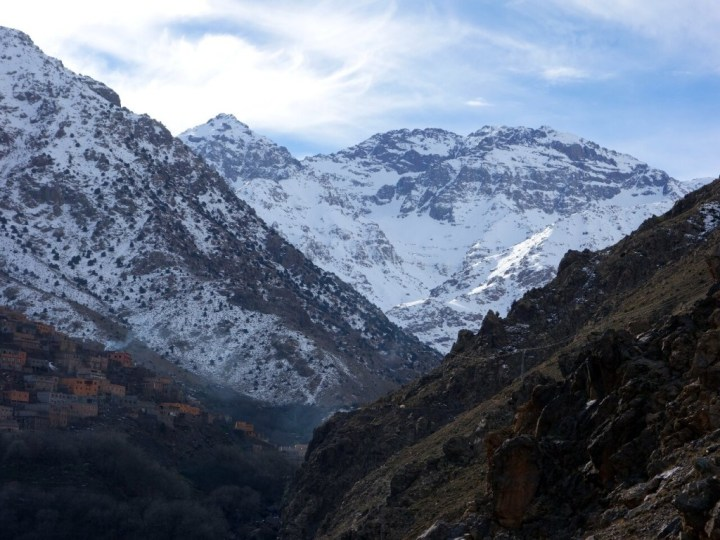 A snowy Jebel Toubkal rises above the village of Aremd