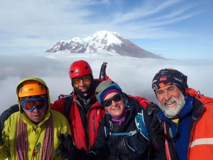 Javier, Marco, Edita and Rodrigo beneath the summit of Carihuairazo, with Chimborazo floating above the clouds