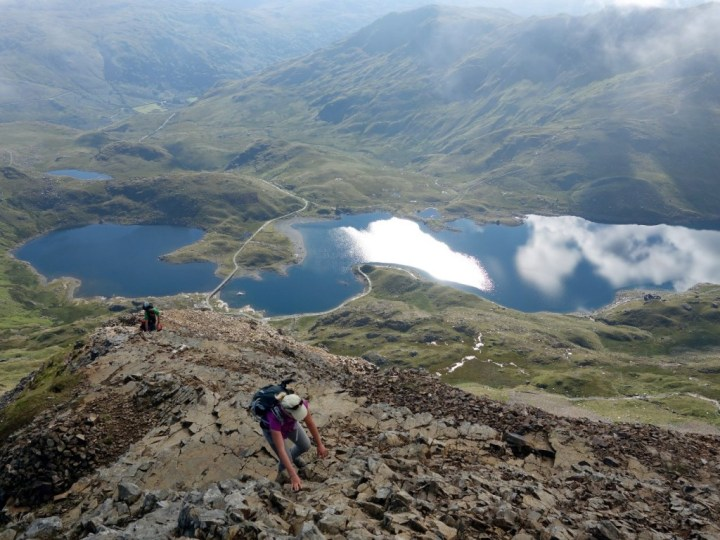 Scrambling up to the Crib Goch ridge, with Llyn Llydaw down below