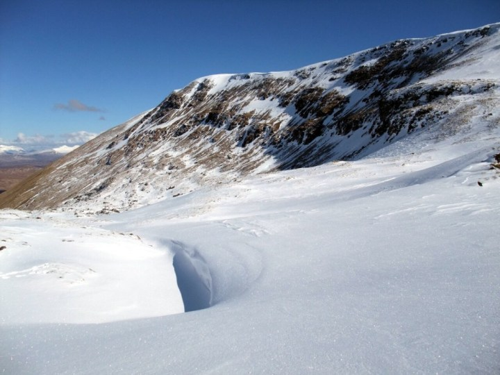 Beinn Achaladair summit ridge seen from deep snow at the top end of Coire Achaladair