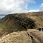 Walkers on the Mynydd Du escarpment