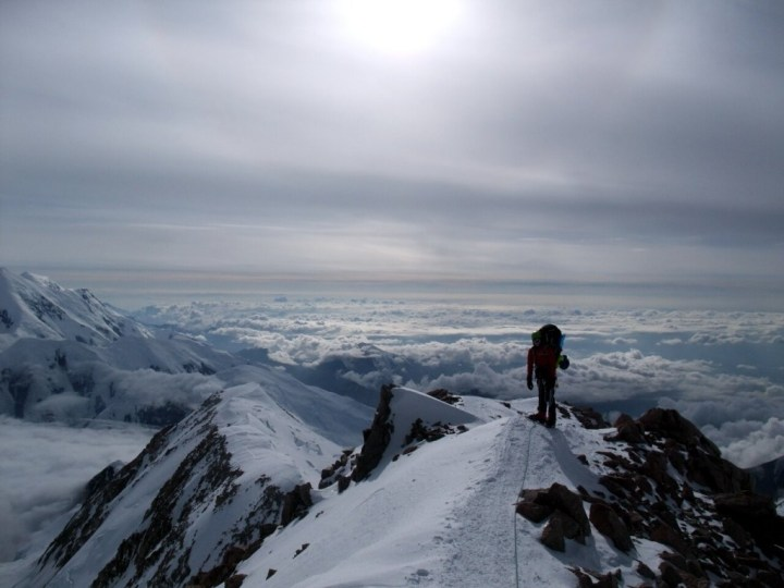 On the crest of the West Buttress ridge, high above the clouds