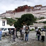 The team prepare for a tour of the Potala Palace