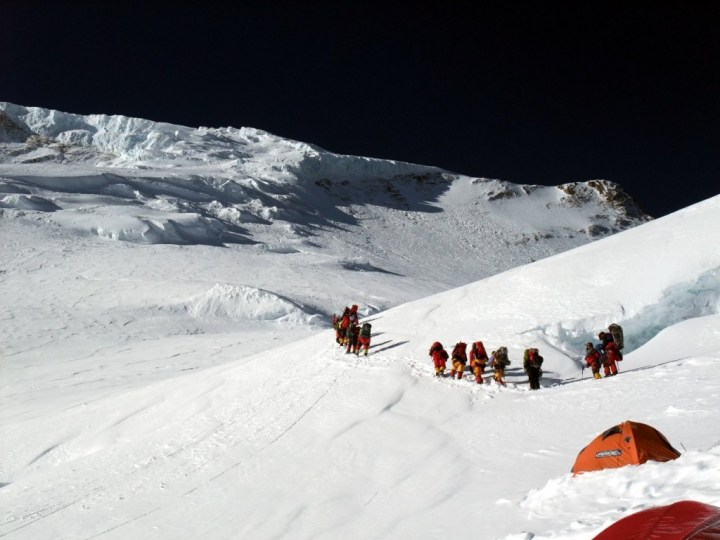 Climbers leaving Camp 3 for Camp 4, with the serac field ahead of them
