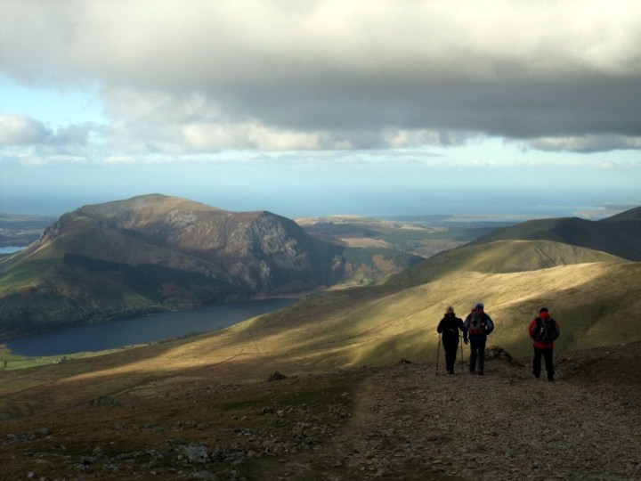 Walkers on the Snowdon Ranger Path, with Mynydd Mawr below
