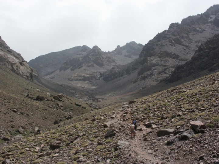 The dusty desert landscape of the Moroccan High Atlas in summer. This view of the approach to Toubkal Refuge was snow-covered last month.