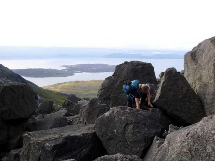 Scramble up to Coir a' Ghrunnda, with the islands of Rum and Soay behind