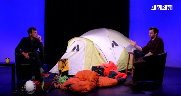 Superstar mountaineer and artistic director Iwan Lewis sit 2m apart on stage, separated by a tent (Picture: Barn Theatre, Cirencester)