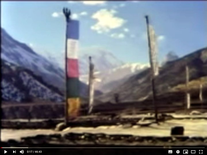 Tilicho Peak hides behind prayer flags: the film quality is a little dated, but the scenery is spectacular