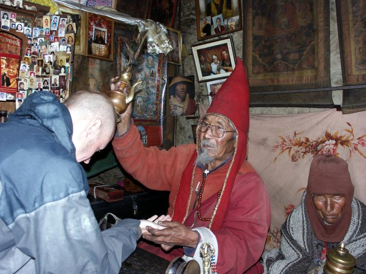 I receive a blessing from Lama Tashi in his cave above Manang in 2006