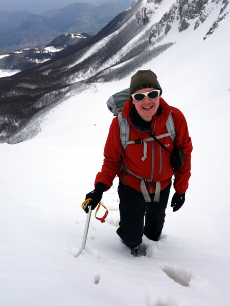 Me in knee-deep snow halfway up the first snow couloir
