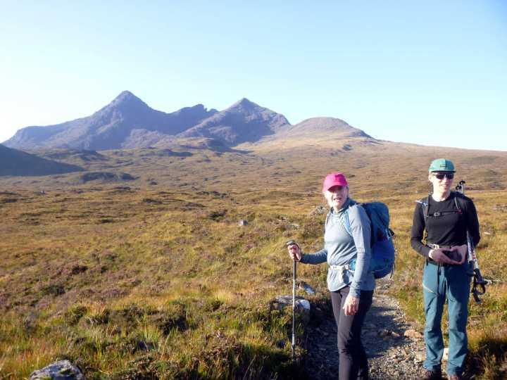 Edita and Dave on the trail across heather from Sligachan, with Sgurr nan Gillean, Am Basteir and Sgurr a Bhasteir behind