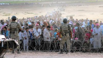 refugees waiting to cross turkey.jpg