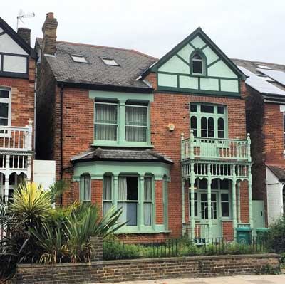 Note the use of red brick, bay and gable and even a Gothic window!