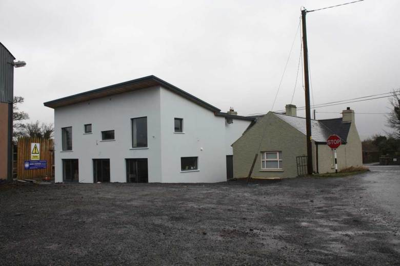 'As built' similar view of mono pitched contemporary extension to traditional two storey Irish (County Sligo) farmhouse